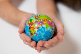 Kid holding little World Globe on her Hands